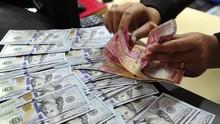 Virus Corona Menggila, Rupiah Amblas ke Rp14.025 per Dolar AS