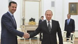 ISIS Hancur, Putin Jamu Assad Bahas Perdamaian