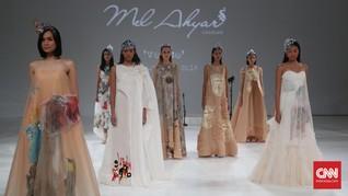 Romantisme Puisi dan Lukisan di Couture Mel Ahyar