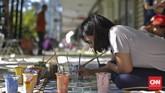Kolaborasi kedua lembaga itu bertujuan menghasilkan seni di ruang publik yang menarik dan bisa mengubah karakter masyarakat kawasan Cikini.(CNN Indonesia/Adhi Wicaksono)