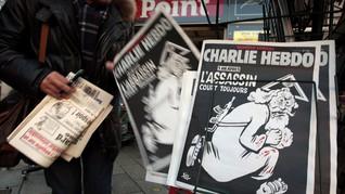 Koran Vatikan Kritik Edisi Setahun Tragedi Charlie Hebdo