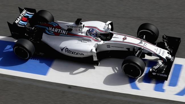 Valtteri Bottas menjajal mobil FW-38 Williams di Sirkuit Katalonia. Meski mempertahankan warna musim lalu, Williams mengatakan ada perubahan pada mesin mobil. (Getty Images/Clive Mason)