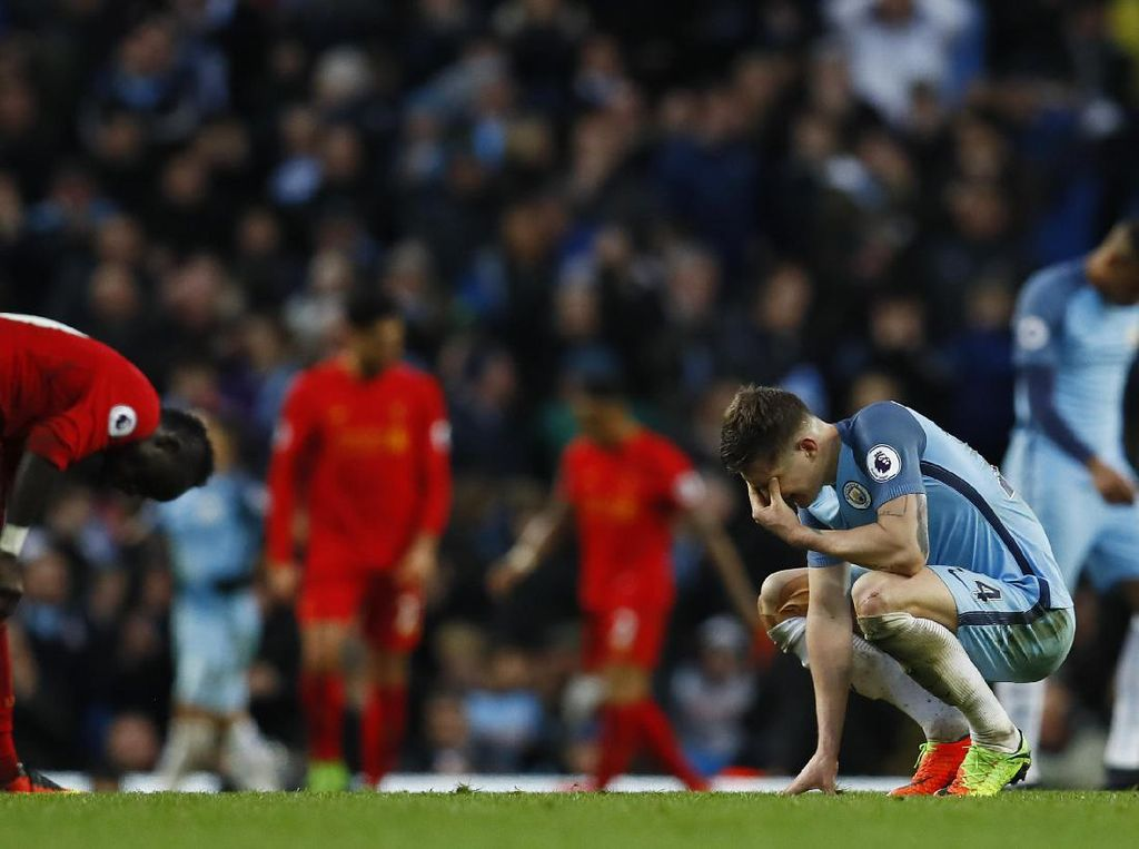 Dengan hasil ini, City tetap duduk di posisi ketiga klasemen sementara Premier League dengan perolehan 57 poin dari 28 pertandingan. Liverpool berada tepat di bawah mereka dengan 56 poin dari 29 laga. Reuters/Jason Cairnduff.