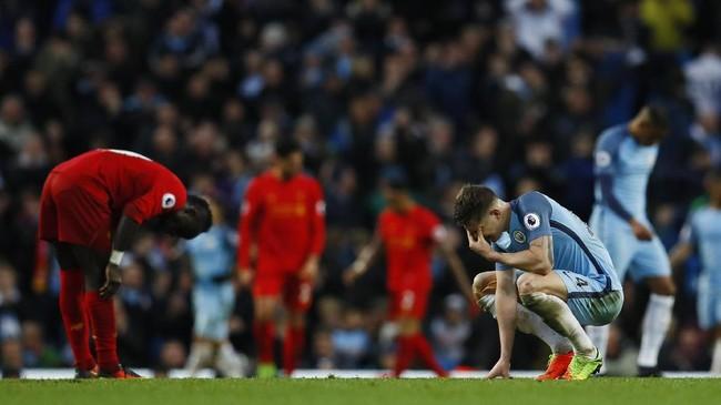 <p>Hasil imbang di Stadion Etihad tidak mengubah posisi Manchester City dan Liverpool. ManCity tetap di peringkat tiga dengan 57 poin, unggul satu poin atas Liverpool di posisi keempat. (Reuters / Jason Cairnduff)</p>