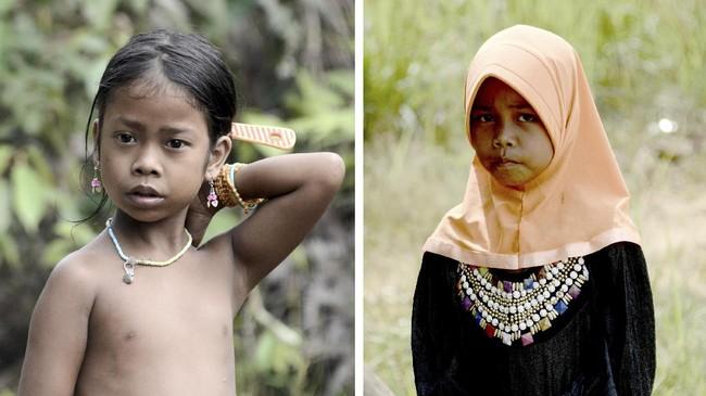 Foto perbandingan anak Orang Rimba yang sudah masuk Islam (kanan) dengan anak yang belum masuk Islam (kiri). Di Jambi, terdapat kurang lebih 3500 anggota suku Rimba. (AFP PHOTO / GOH CHAI HIN)
