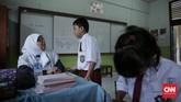 Drama anak ngambek di sekolah ini biasanya dialami oleh orang tua yang anaknya baru masuk kelas satu sekolah dasar atau bahkan masuk TK. (CNN Indonesia/ Hesti Rika)