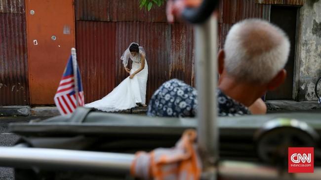 Sore hari merupakan waktu terbaik untuk mengabadikan momen di Lebuh Armenian. Lokasi ini sering digunakan untuk foto pra-nikah.