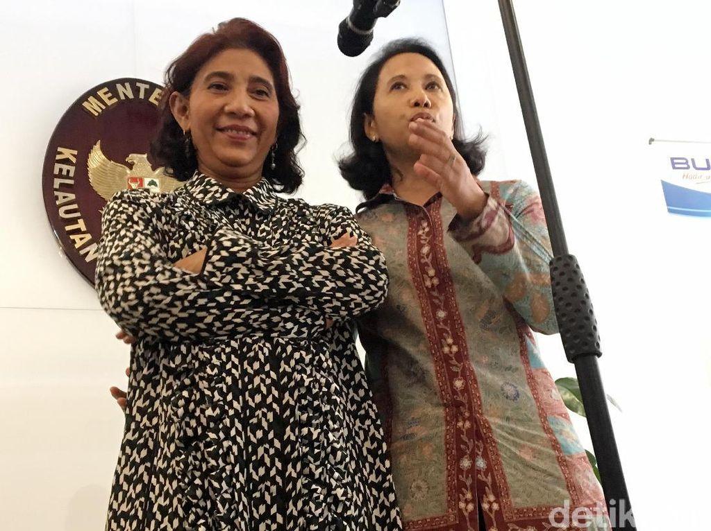 Begini gaya Menteri Kelautan dan Perikanan Susi Pudjiastuti bersama dengan Menteri BUMN Rini Soemarno.