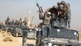 <p>Dalam waktu kurang dari sehari, konvoi kendaraan lapis baja dari Pasukan Kontra-Terorisme elite Irak yang dilatih Amerika Serikat merebut kantor pusat pemerintahan Provinsi Kirkuk. (AFP Photo/Ahmad Al-Rubaye)</p>