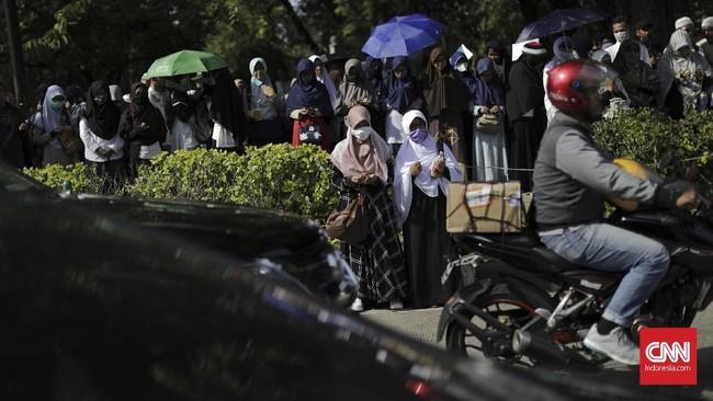 Dalam aksi ini, para peserta juga melakukan doa bersama untuk Palestina usai kebijakan AS mengklaim Yerusalem sebagai ibu kota Israel.(CNN Indonesia/Adhi Wicaksono).