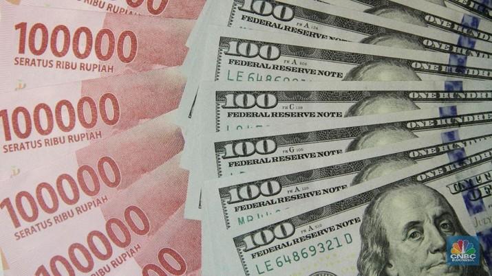Pukul 12:00 WIB: Rupiah Masih Lemah di Rp 14.300/US$