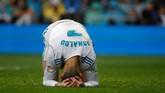 Penyerang Real Madrid Cristiano Ronaldo menyesal gagal memanfaatkan peluang. Hingga laga usai skor 1-0 untuk Villarreal tetap bertahan. (REUTERS/Javier Barbancho)