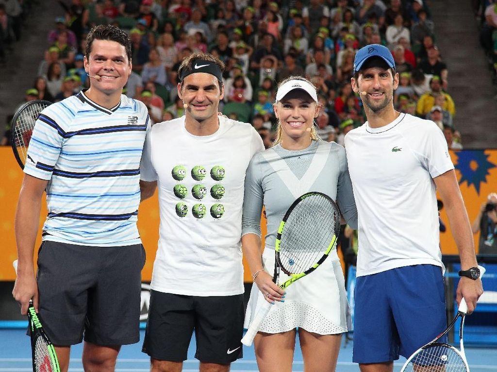 Bertanding dengan para superhero sedikit melepas ketegangan Raonic, Federer, Wozniacki, dan Djokovic jelang Australia Terbuka yang bergulir 15 Januari ini. Foto: Graham Denholm/Getty Images