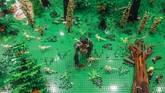 Dunia Jurasik yang terbuat darimainan LEGO ditampilkan selama pameranLEGO di Stadion Wroclaw di Wroclaw, Polandia pada 17 Januari 2018. (Anadolu Agency/Omar Marques)