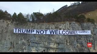 VIDEO: Spanduk Tolak Trump Dipasang Sepanjang Zurich-Davos