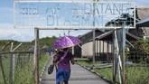 Sebanyak 68 orang di Kabupaten Asmat meninggal dunia karena wabah gizi buruk.Puluhan lainnya harus menjalani perawatan intensif di rumah sakit dan tempat darurat. (AFP/Bay Ismoyo)