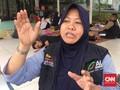 Perjuangan Nuryani, Ibu Rumah Tangga Relawan Banjir Jakarta