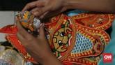 Di Jawa, Wayang potehi merupakan wayang para dewa karena digelar di kelenteng sebagai ungkapan rasa syukur kepada para dewa. Preservasi Wayang Potehi terjadi di daerah Jawa Timur, seperti Blitar, Gudo (Jombang), Malang, Tulunggagung, Sidoarjo. (CNN Indonesia/Andry Novelino)