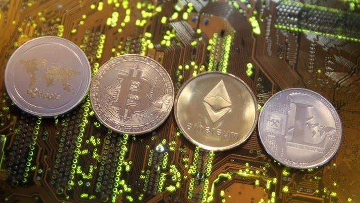 FILE PHOTO: Representations of the Ripple, Bitcoin, Etherum and Litecoin virtual currencies are seen on a PC motherboard in this illustration picture, February 13, 2018. Picture is taken February 13, 2018. REUTERS/Dado Ruvic/File Photo