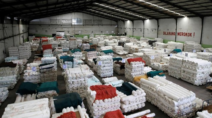 Rolls of cloth are stacked in the warehouse of a textile factory which has its own water treatment facilities located near the Citarum river in Majalaya, south-east of Bandung, West Java province, Indonesia, February 14, 2018. REUTERS/Darren Whiteside