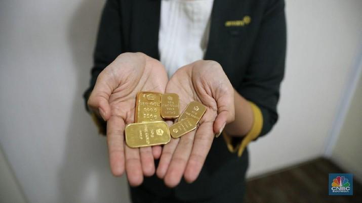 Harga emas dunia nyaris tembus ke bawah level psikologi US$ 1.400/troy ounce, tetapi