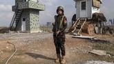 Menjadi seorang tentara Irak Kurdi Peshmerga bukan pilihan yang biasa.Arazo Qadriadalah seorang tentara perempuan yang dianggap tangguh karena mengisi profesi yang biasanya dilakukan pria. (AFP PHOTO / SAFIN HAMED).