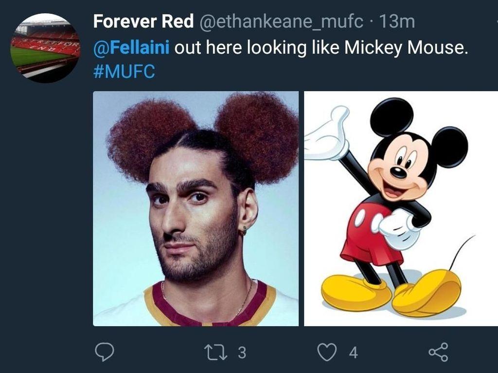 Gaya rambut Fellaini memang mirip Mickey Mouse sih, tokoh kartun Disney yang tersohor itu lho. (Foto: Twitter @ethankeane_mufc)