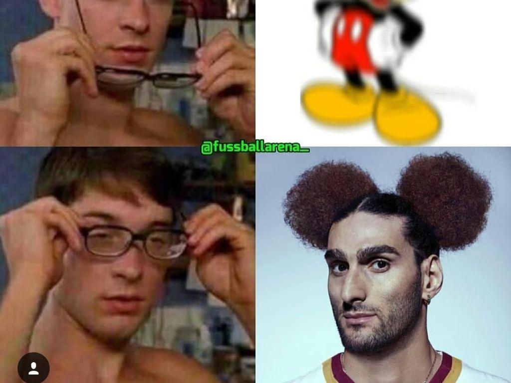 Tidak, kalian tidak salah lihat kok. Itu Fellaini, bukan Mickey Mouse. (Foto: Instagram @fussballarena_)