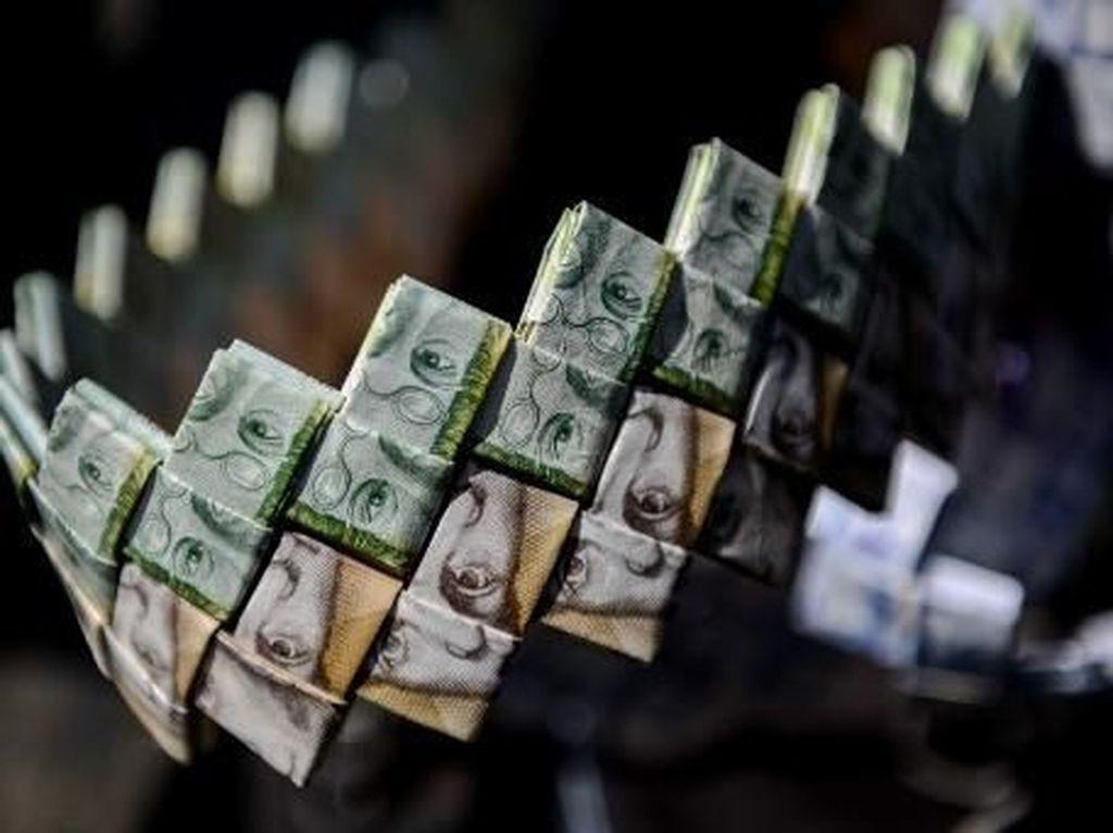 Seni origami dari uang kertas Venezuela. Federico Parra/AFP.