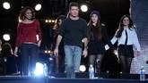 Keberadaan Fifth Harmony dalam industri musik tak dapat dilepaskan dari campur tangan 'bapak' mereka, Simon Cowell.(Jason Merritt/Getty Images/AFP)