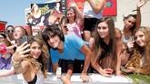 Ketenaran pun perlahan tapi pasti diraih Fifth Harmony pada 2014. Para penggemar mereka, Harmonizer, semakin bertambah dengan kefanatikan yang solid.(Jemal Countess/Getty Images/AFP)