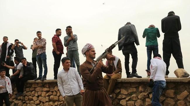 Peringatan tahun baru Noruz terlah berlangsung sejak ribuan tahun silam dan sudah tercatat sebagai Daftar Warisan Budaya TakBenda Manusia UNESCO sejak 23 Februari 2010.(REUTERS/Ari Jalal)