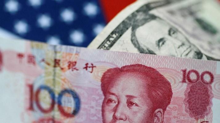 Nilai tukar yuan secara mengejutkan melemah tajam melawan dolar AS.