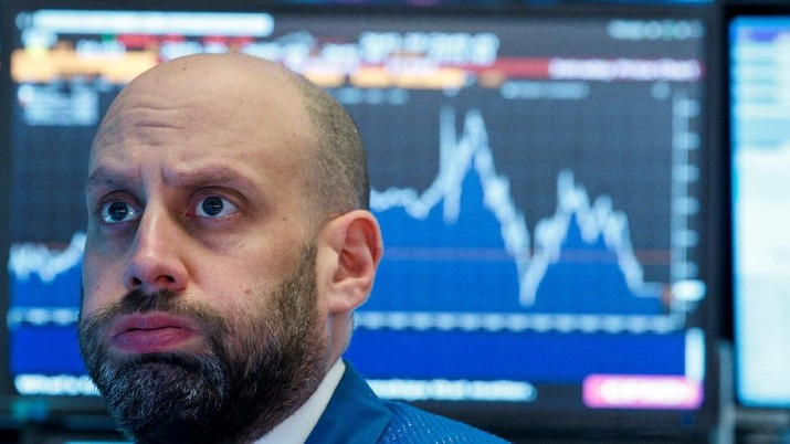 Specialist trader Meric Greenbaum works at his post on the floor of the New York Stock Exchange, (NYSE) in New York, U.S., March 22, 2018. REUTERS/Brendan McDermid