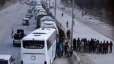 Pemberontak Suriah Menyerah dan Keluar dari Ghouta dengan Bus