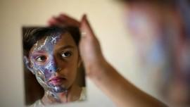 FOTO: Sapuan Rona di Wajah Gaza
