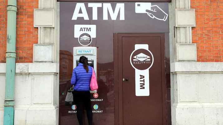 A woman withdraws money from an ATM machine in Nice, France, April 3, 2018. REUTERS/Eric Gaillard