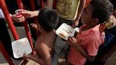Kelompok yang terdiri lebih dari 1.000 orang itu berjalan dari Amerika Tengah menuju AS untuk mencari suaka. (REUTERS/Henry Romero)