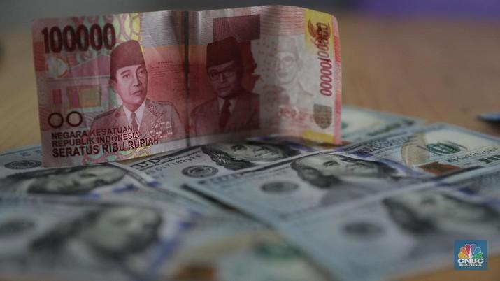 Pada Selasa (24/9/2019), US$ 1 dibanderol Rp 14.100/US$ di pasar spot. Rupiah melemah 0,14% dibandingkan dengan posisi penutupan perdagangan hari sebelumnya.