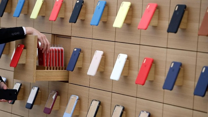 iPhone cases are displayed on a wall at the Apple Shinjuku store during a press preview ahead of it's grand open in Tokyo, Japan April 5, 2018.  REUTERS/Issei Kato