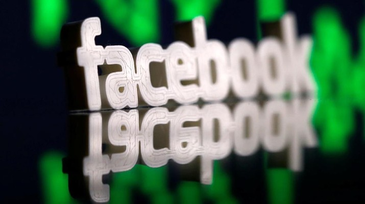A 3D-printed Facebook logo is seen in front of displayed stock graph in this illustration photo March 20, 2018. Picture taken March 20. REUTERS/Dado Ruvic