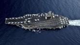 Formasi di atas Kapal Induk USS Theodore Roosevelt di Selat Malaka, 1 April 2018. (US.Navy/Mass Communication Specialist 3rd Class Anthony J. Rivera/Handout via REUTERS)