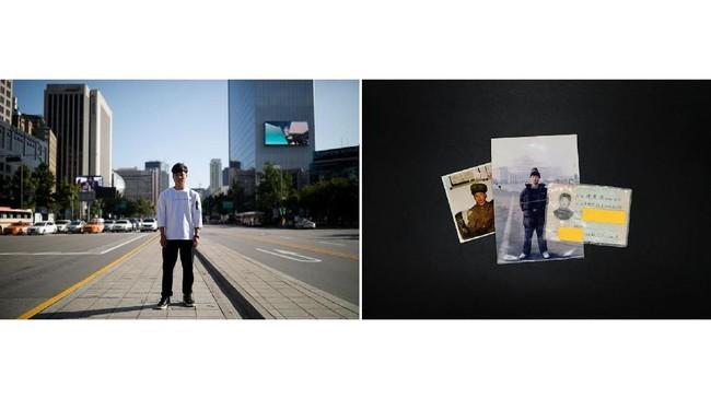 Lee Oui-ryuk, 29 tahun dan kartu identitas Korea Utara miliknya. Dia berasal dari Onsong, dekat perbatasan China, membelot pada 2010. Golongan darahnya 'O' tapi di kartu identitas Korea Utara ditulis 'A'. (REUTERS/Kim Hong-ji)