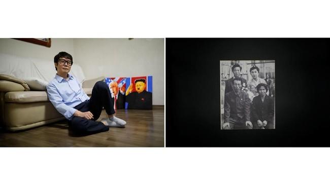 Song Byeok, 48 tahun dan foto keluarganya. Dia adalah seorang seniman propaganda. Ayahnya tewas tenggelam saat berusaha berenang menyeberangi Sungai Tumen pada 2000. Dia akhirnya berhasil meninggalkan Korut pada 2001, membawa sejumlah foto keluarga. (REUTERS/Kim Hong-ji)