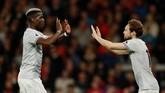 Paul Pogba diganti Daley Bland pada menit ke-80 setelah memberikan assist kepada Romelu Lukaku yang mencetak gol kedua Man United ke gawang Bournemouth. (Reuters/John Sibley)