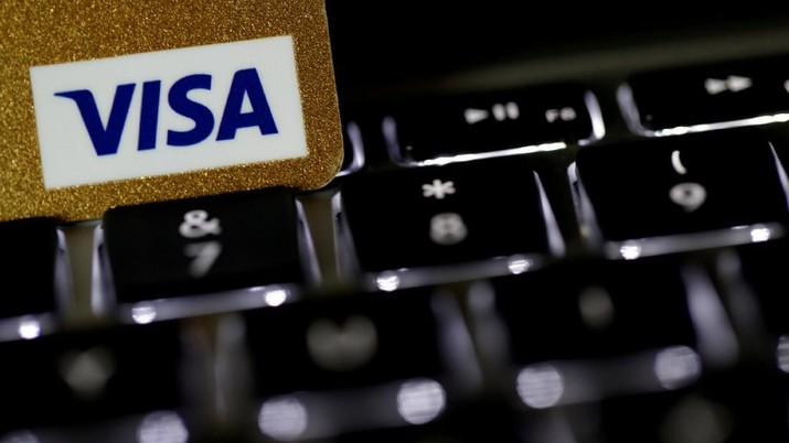 FILE PHOTO: A Visa credit card is seen on a computer keyboard in this picture illustration taken September 6, 2017. REUTERS/Philippe Wojazer