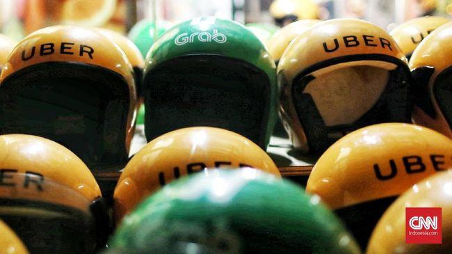 Dituding Monopoli, Singapura Ajukan Denda untuk Grab-Uber