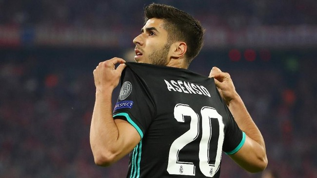 Real Madrid berbalik unggul pada menit ke-57 lewat gol Marco Asensio yang memanfaatkan blunder bek Bayern Munchen Rafinha. (REUTERS/Michael Dalder)