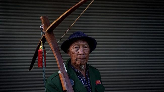 Bagi masyarakat Desa Lisu di tengah pedalaman perbatasan China dan Myanmar, memanah adalah tradisi mereka sejak 200 SM. (REUTERS/Aly Song)