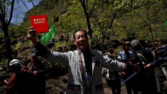 Namun pemerintah juga sempat melarang aktivitas perburuan yang biasa digunakan masyarakat Desa Lisu untuk memenuhi kebutuhan sehari-hari. (REUTERS/Aly Song)